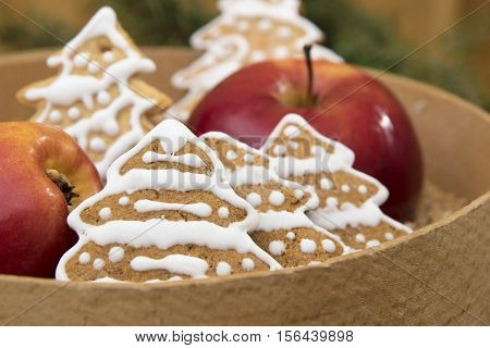 Christmas decoration apple and gingerbread on wooden background
