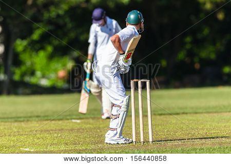 Cricket teenagers schools game batsman ready for bowler action photo.