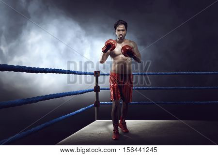 Professional Asian Boxer Guy With Glove Was Practicing