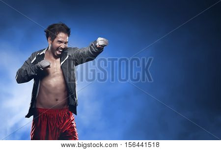 Action Asian Man Boxer With Strap In His Hand