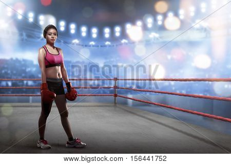 Sexy Asian Female Boxer With Boxing Gloves Standing In The Boxing Ring