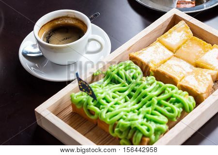 Bread Custard On Wooden Plate And Coffee