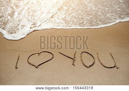 I love you - message on the sand beach near sea - love concept
