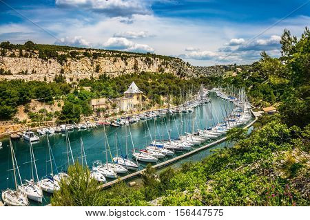 Calanque National Park - small fjords between Marseille and Cassis. Picturesque small bay - Calanques with turquoise water. White sailboats moored in rows near the shore