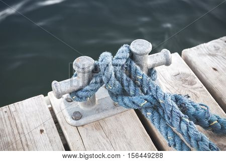 Mooring Bollard With Tied Blue Rope