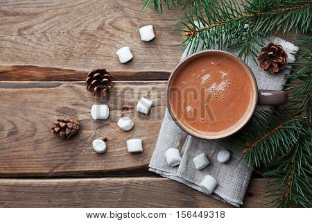 Cup of hot chocolate on rustic table from above. Delicious winter drink. Flat lay.