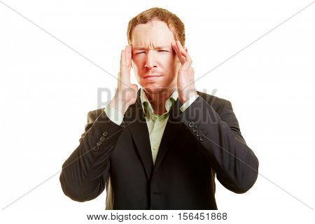 Man with migraine holding his hands on his temples and looking frustrated