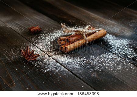 Fresh Cinnamon Sticks On The Black Wooden Table