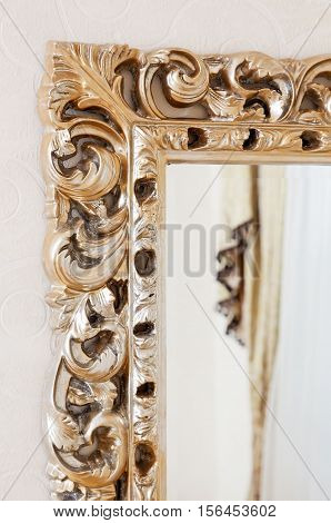 Part of golden baroque classical mirror frame