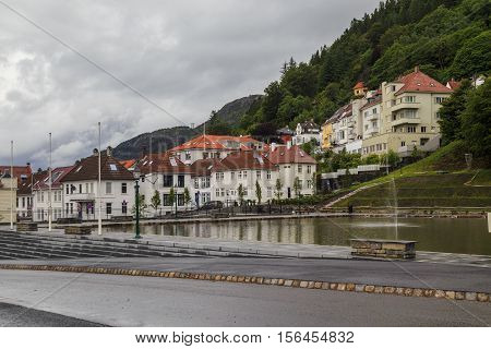 BERGEN, NORWAY - 3 JULY, 2016: This is pool with a fountain located in a upland residential zone Fjellet Nord.
