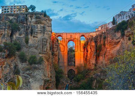 Puente Nuevo, New Bridge, at night illuminated over the Tajo Gorge in Ronda, Andalusia, Spain