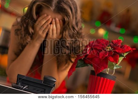 Christmas can be a stressful holiday. Frustrated woman waiting for a phone call.