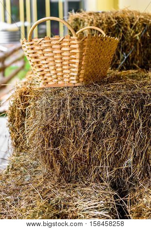 Basket on top of hay stack on a ranch. A typical farming and agricultural scenic picture.