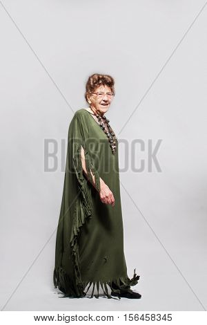 Stylish 90 years old woman at studio. Granny female