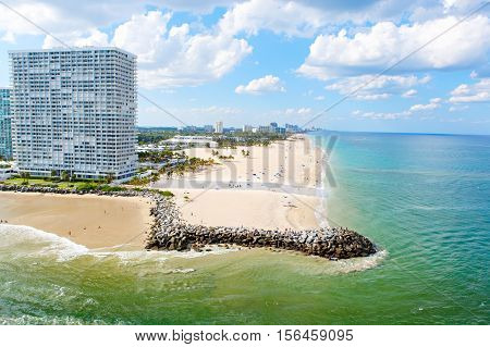 Aerial view of Miami South Beach, Florida, USA. With surfers and people taking bath and swimming. poster