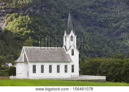 Traditional norwegian white wooden church. Fortun village. Travel Norway. Horizontal
