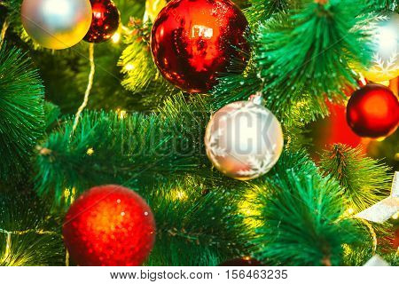 Beautiful Decorated Christmas Tree With Red And Goldish Baubles And Garland, In The New-year Backgro
