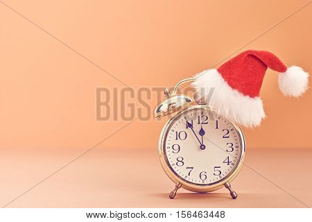 New Year background decoration Handmade, Christmas holiday Gold Alarm Clock, Santa hat, Happy New Year 2017. XMAS Design Ornament. Festive Art christmas Greeting Card. Retro Vintage