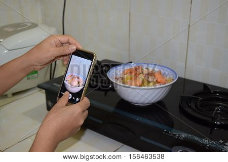 Hand Capture Rice Noodle With Seafood