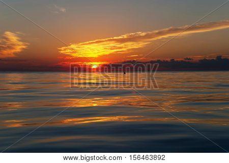 Sun rises above Lake Michigan, Chicago, Illinois, USA