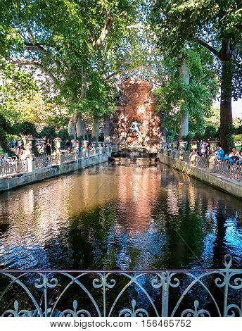 PARIS, FRANCE-JULY 28, 2016:  Fountain Medicis in Luxembourg Garden, probably the most popular park in Paris in the late afternoon