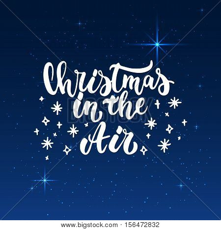 Christmas in the Air - lettering Christmas and New Year holiday calligraphy phrase isolated on the background. Fun brush ink typography for photo overlays, t-shirt print, poster design