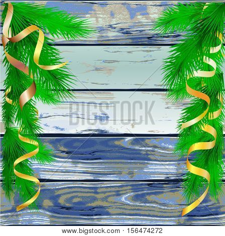 Wooden grunge christmas background of planks and needles with gold ribbons. Blue cracked board of planks with green fir twigs