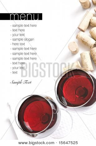 Winery menu project. Two glasses of red wine, corks on white table cloth. Space for text isolated on white.