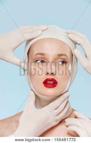 Portrait of model with unusual image. isolated biege background