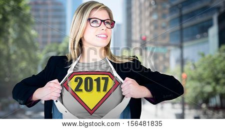 Businesswoman opening shirt in superhero style against blur view of a modern city