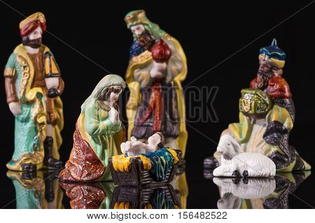 Christmas Manger scene with figurines including Jesus Mary and magi. Focus on Mary!