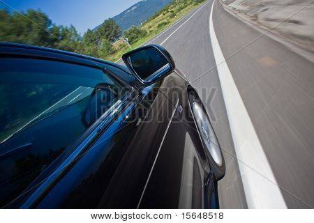 car driving fast on a road