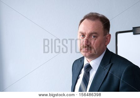Portrait of a serious middle age businessman