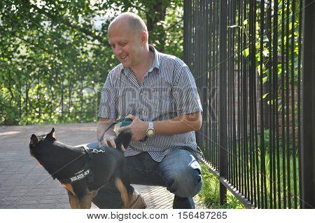 Smiling Bald Man With Dog