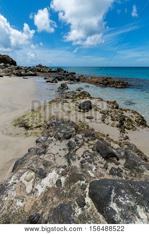 Rocks at the edge of the clear blue sea in Saint Lucia