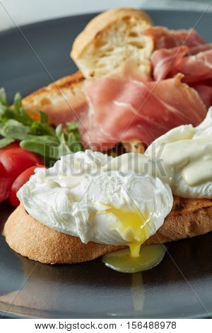 Eggs Benedict with bacon,