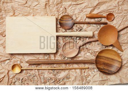 wooden kitchen utensil on baking paper