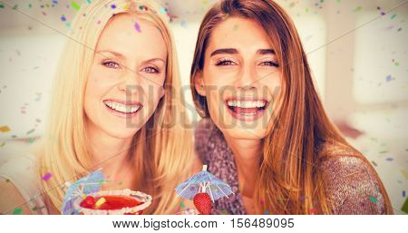 Portrait of beautiful women having mocktail against flying colours
