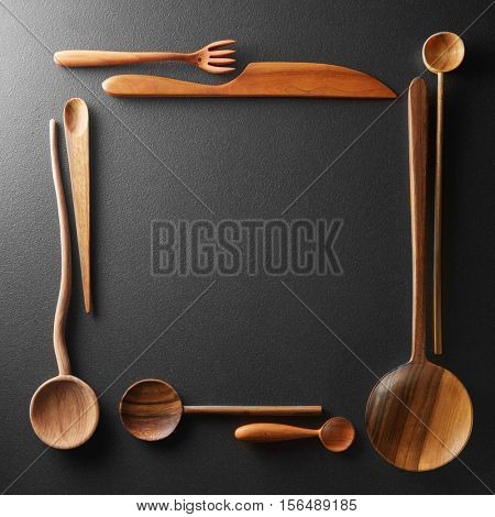 frame of wooden spoons, forks and a knife