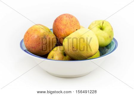 Windfall Apples Grouped In A Bowl On A White Background.