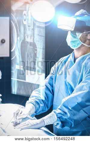 Medical interface on xray against surgeon performing operation in operation room