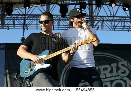 LAKE WALES, FL-NOV 4: Chris Janson (R) performs at the CountryFlo Music and Camping Festival on November 4, 2016 in Lake Wales, Florida.