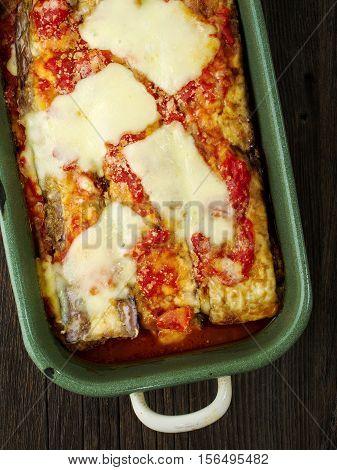 close up of rustic traditional italian eggplant parmesan