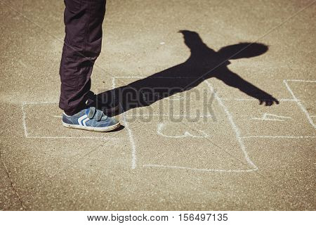 kid playing hopscotch on playground, children outdoor activities