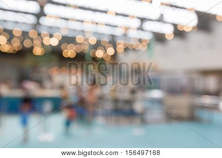 Background blur of car in showroom. Businessmen blur in the workplace. abstract interior office with car. Abstract background of car industry shallow depth of focus.