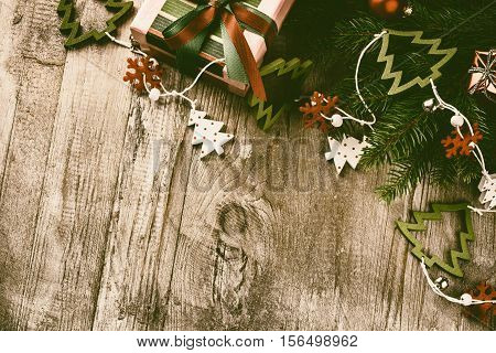 Christmas decorations in vintage style over old wood background. Christmas border with copy space