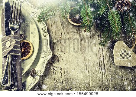 Christmas table setting in silver tone on old wooden table. Christmas background with copy space