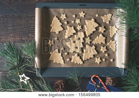 Christmas cookies on the baking tray with different accessorizes top view