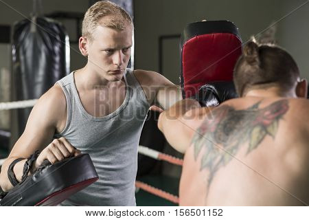 Boxer Exercising With Trainer