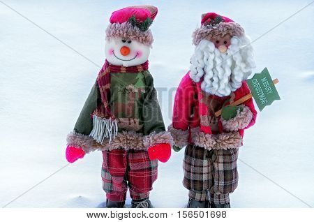 two Christmas toys on a snow background